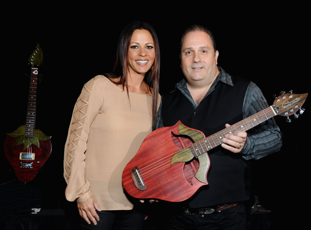 LAS VEGAS, NV - MARCH 31:  Singer Sara Evans (L) and Doug Ranno attend the Gift Lounge for the 47th Annual Academy Of Country Music Awards held at the MGM Grand Hotel/Casino on March 31, 2012 in Las Vegas, Nevada.  (Photo by Angela Weiss/ACMA2012/Getty Images for ACM) *** Local Caption *** Sara Evans; Doug Ranno