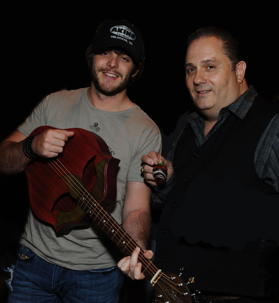 31 of 567     Print all In new window Thomas Rhett and Doug Ranno at the Nashville Lifting Lives Guitar signing in LV