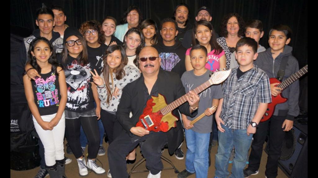 Musical Harvest Donates Guitars to Sam's School of Rock